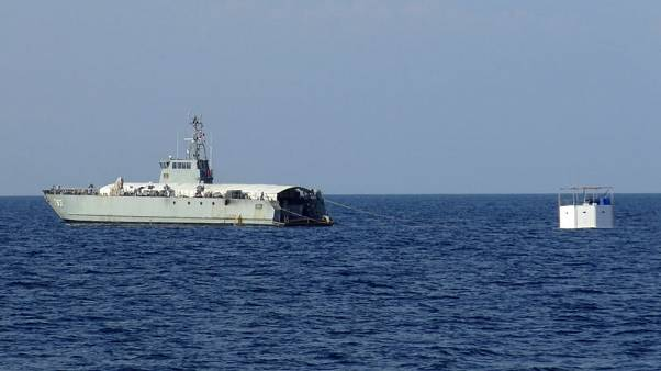 Thai navy tows floating home of fugitive U.S. 'seasteader'