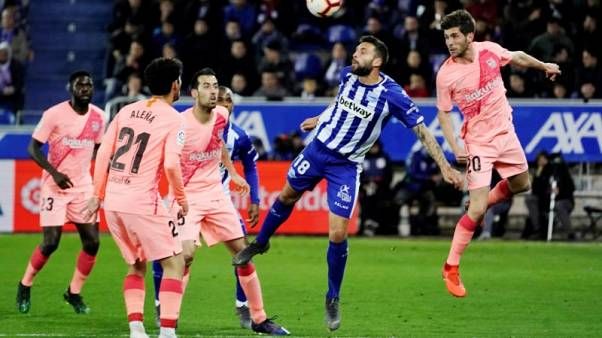 Barcelona on verge of Liga title after beating Alaves