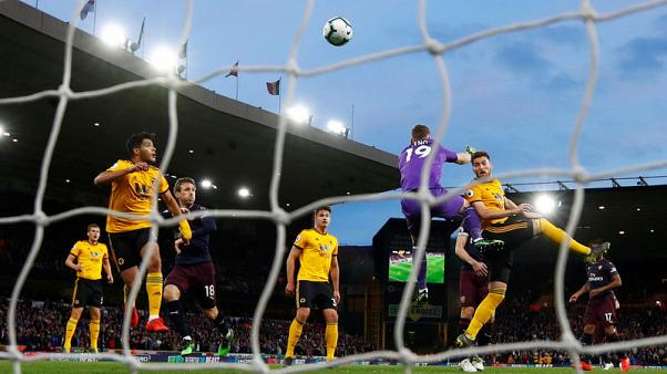 Arsenal's top-four hopes dented by defeat at Wolves