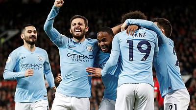 Manchester City take big step towards title with derby win at United