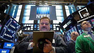 World stocks slip as growth fears linger; euro slides
