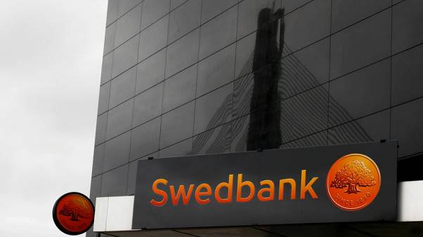 Swedbank first-quarter profit above forecast, says cooperating with U.S. authorities