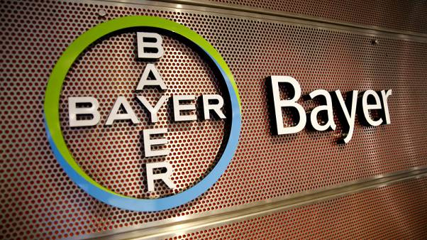 Bayer's profit gets boost from Monsanto but legal burden mounts