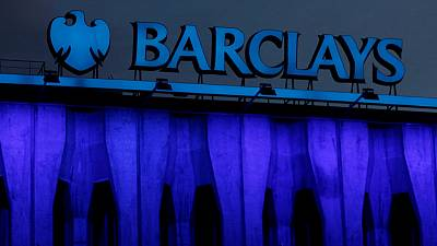 Barclays hit by struggling investment bank, flags cost cuts