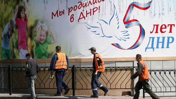 Putin - nothing wrong with us giving passports to east Ukraine residents