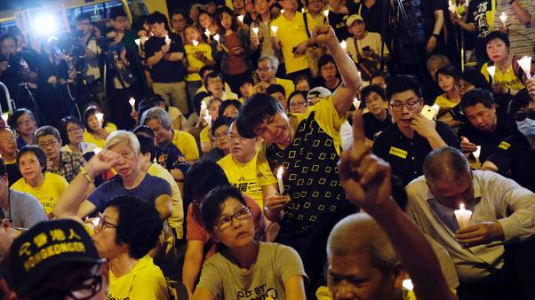 Britain says jailing of Hong Kong pro-democracy activists is deeply disappointing