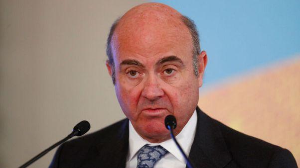ECB's de Guindos keeps door open to more QE 'if needed'