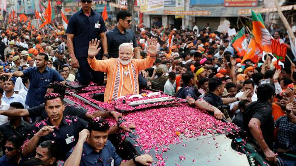 Huge crowds greet India's Modi in his sacred city seat