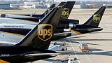 UPS profit hurt by severe weather, issues disappointing outlook for second quarter; shares sink