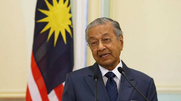 Support for Malaysian PM drops as concerns grow over economy, race - survey