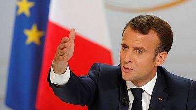 Macron's move to scrap elite school alarms powerful alumni network
