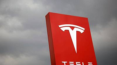 Ending tough week, Tesla shares sink to lowest level in two years
