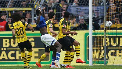 Dortmund's title hopes dented by shock home loss to Schalke