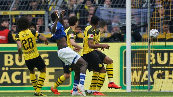 Dortmund's title hopes dented by shock home loss to Schalke
