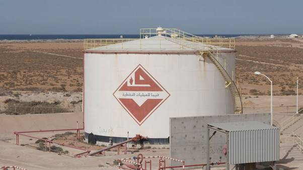 Eastern Libyan forces send warship to oil port, NOC condemns militarization of facilities