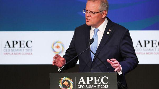 Australian PM promises migration cut, refugee freeze if re-elected