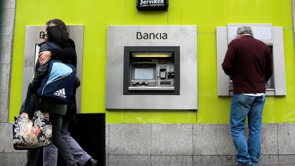 Spain's Bankia first-quarter net profit drops on lower trading income