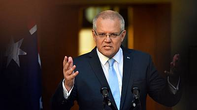 Australian PM clashes with rival in feisty debate as poll tightens