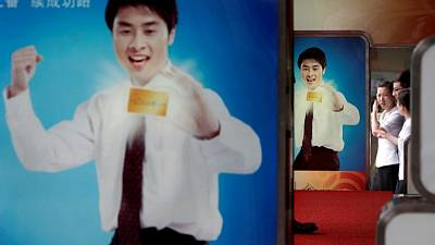 Indebted Chinese seek wisdom of credit card 'goddesses' as retail lending surges
