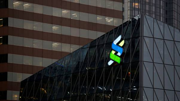 Standard Chartered flags turnaround progress with $1 billion buyback plan, shares rise