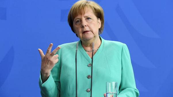 Germany's Merkel rejects speculation about early exit