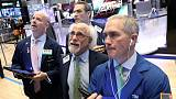 Global stocks fall, dollar gains on Powell comments