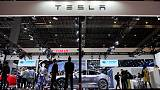 Tesla raises size of share sale, Musk to buy more