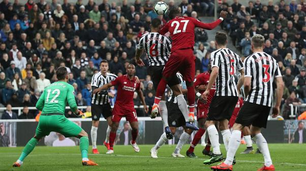 Late Origi header keeps Liverpool's hopes alive