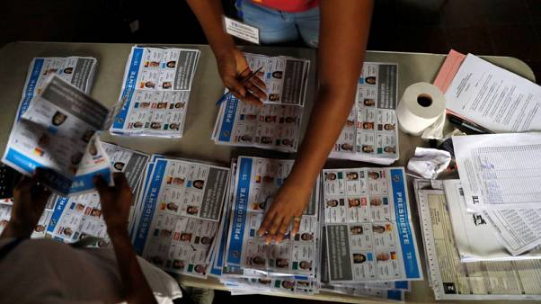 Panama presidential candidate Cortizo holds narrow lead with half the votes counted