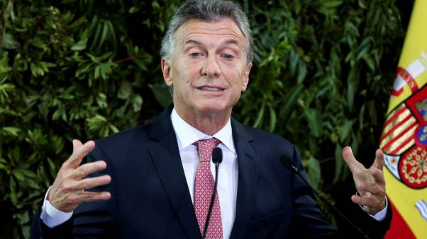 Argentina's Macri seeks accord with rivals to calm volatile markets