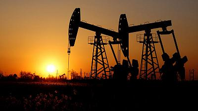 Oil ends at lowest in a month on trade concerns, high U.S crude supplies