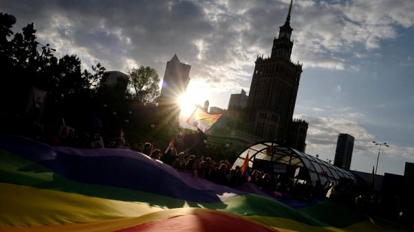 Poles stage protest rally in support of LGBT activist