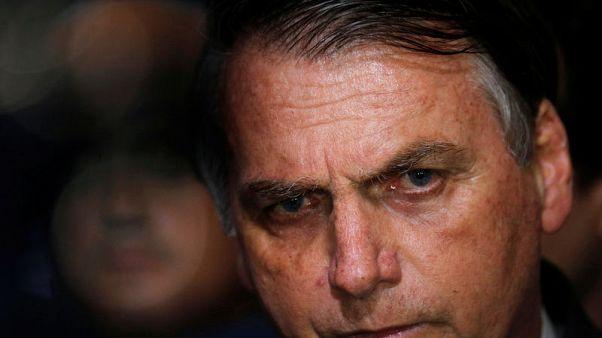 Brazil's Bolsonaro signs decree easing gun import, ammo limits