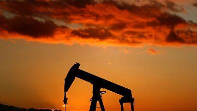 Oil falls as trade row fears outweigh drop in U.S. crude stocks