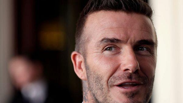 David Beckham gets six-month driving ban for using phone at wheel - BBC