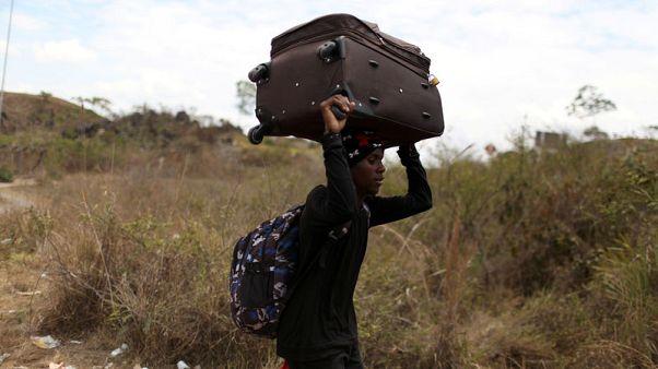 Venezuela reopens border where migrants used trails to reach Brazil