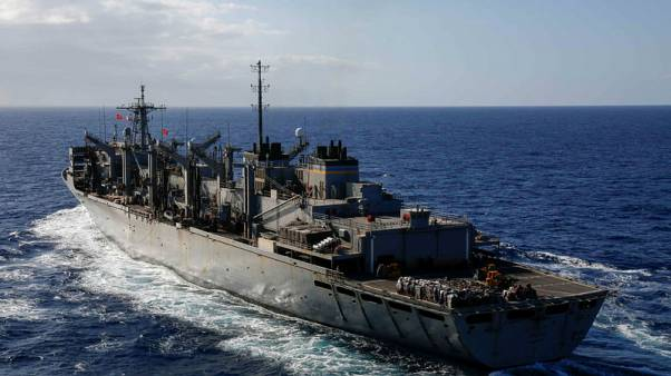 U.S. warns merchant ships of possible Iranian attacks; cleric threatens U.S. fleet