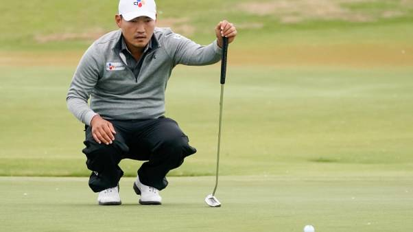 South Korea's Kang bolts clear in Dallas with sparkling 61