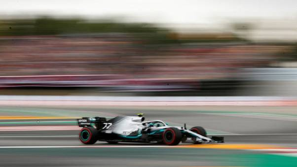 Motor racing - Bottas on pole in Spain for third race in a row
