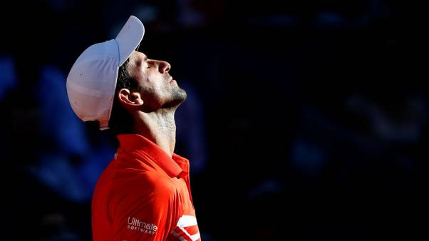 Djokovic back to best against Thiem to reach Madrid final