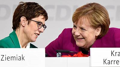 Germany's Merkel should serve full term, says heir apparent