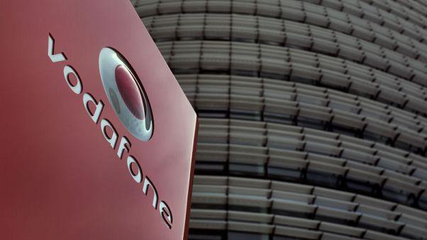 New Vodafone boss tackles debt burden with dividend cut