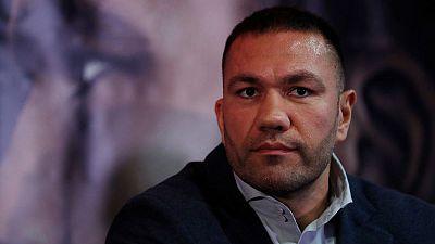Bulgarian boxer suspended in California for kissing broadcaster