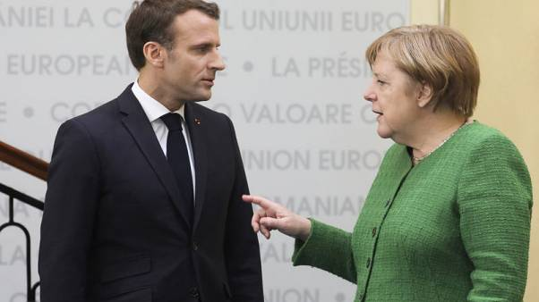 Merkel admits differences with Macron, says they agree on fundamentals