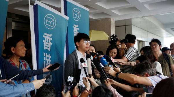Hong Kong democracy leader Joshua Wong sent back to jail