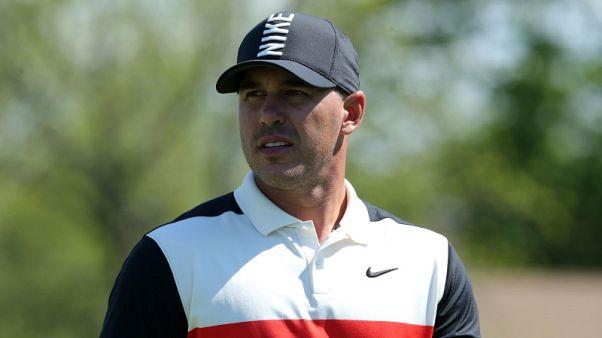 Koepka in control at PGA Championship, Woods nine back