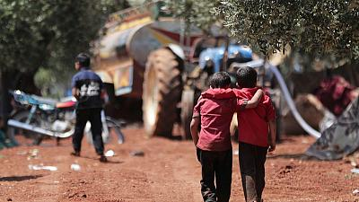 After fleeing bombs, Syrian families shelter in olive groves