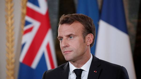 French President Macron says Le Pen's record in EU parliament a 'disaster'