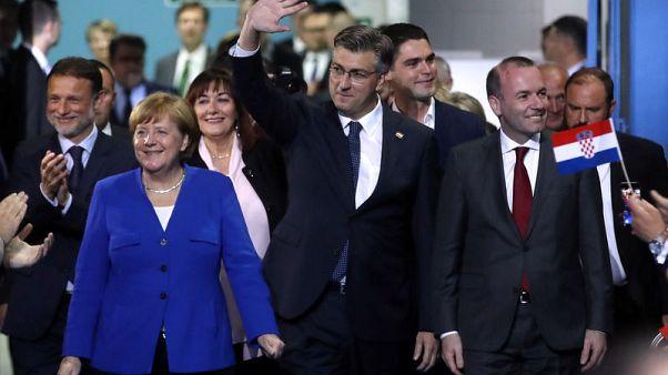 Merkel says Croatia's euro ambitions very realistic