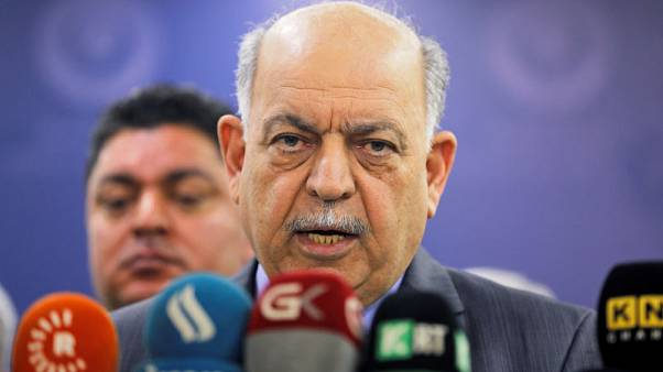 Iraq oil minister says deal with Exxon close, slowed by evacuation